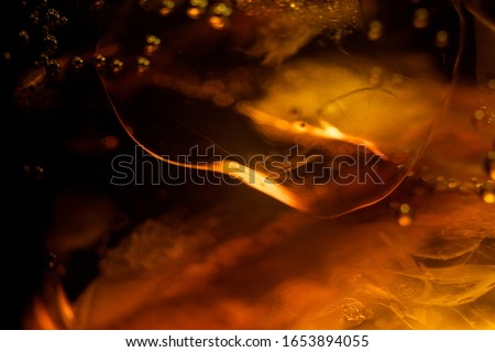 Ice cube in whiskey texture background, macro close up of Ice cubes in glass of whiskey or another alcohol,Crystal design