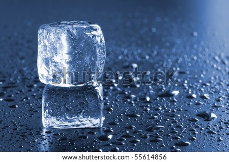 ice cube macro in blue with water drops - stock photo
