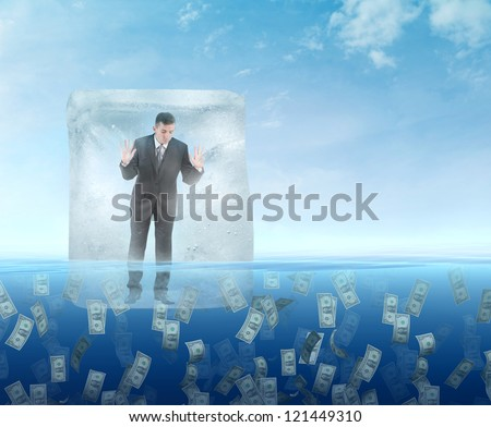 Ice cube with a businessman  floating in the sea of money