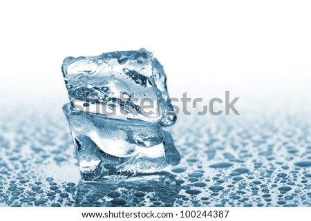 ice cube with water drops, on white background