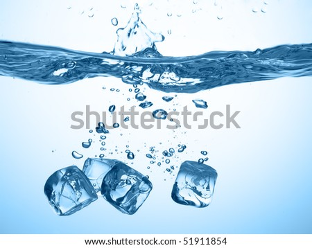 ice cubes dropped into water with splash - stock photo