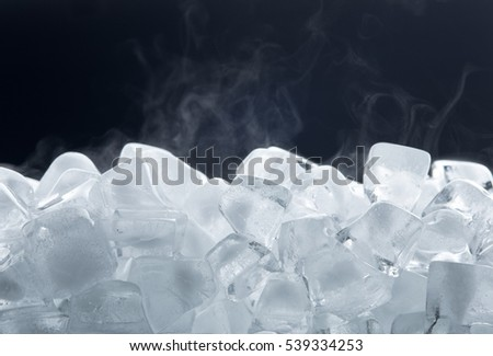 Ice cubes isolated on black background #539334253