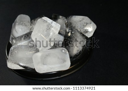 ice cubes on a black background #1113374921