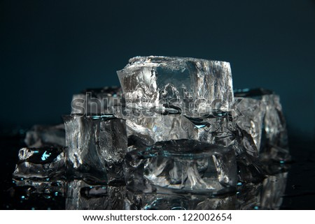 Ice cubes on dark blue background