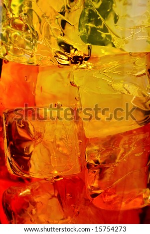 Ice cubes swimming in orange drink.