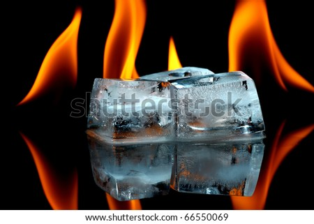 Ice cubes with fire - stock photo