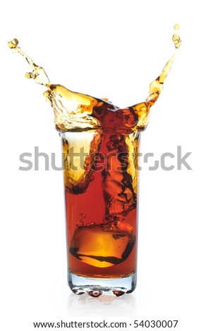 Ice falling in glass with tea - stock photo