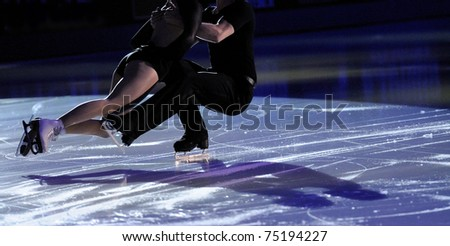Ice figure skating pair with shadows on ice