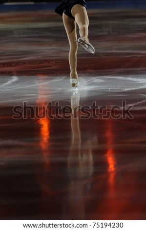 Ice figure skating woman legs on ice with shadows