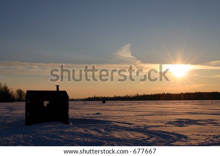 Ice fishing hut on a frozen river