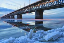 Ice floating on the Amur river. Amur bridge. Trans siberian railway. Khabarovsk, far East, Russia.