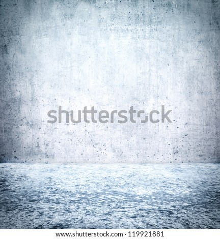 Ice floor with concrete wall background - stock photo