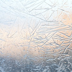 Ice flowers. Window frost. Winter time background. Frozen icy texture. macro view, soft focus