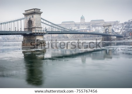 Ice flowing on river Danube in Budapest, Hungary #755767456