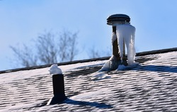 Ice forming on roof vents from moist air in home. Ice plugging sewer vents can create problems.