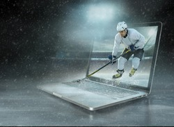 ice hockey Player in dynamic action in a professional sport game play on the laptop in hockey under stadium lights.