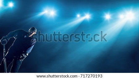 Ice Hockey player is skating on a abstract background with intensional lens flares. He is wearing unbranded sports clothes. #717270193