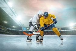 Ice hockey player on the ice. Open stadium - Winter Classic game.