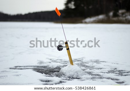 Ice-hole and fishing rod for winter fishing. #538426861
