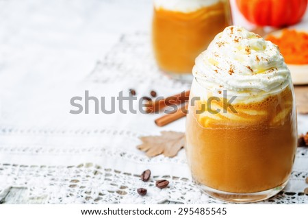 ice honey pumpkin spice latte with whipped cream. the toning. selective focus