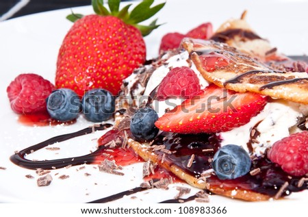 Ice in fresh Pan Cake with mixed fruits on black background