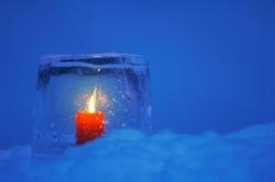 Ice lantern in snow at dusk