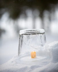 Ice lantern with yellow candle