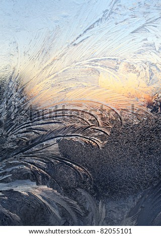 ice patterns and sunlight on winter glass