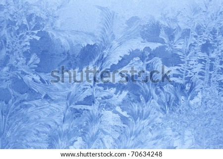 ice patterns on winter glass - stock photo