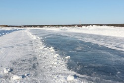 Ice road on a frozen reservoir in the winter,  Ob River, Siberia, Russia