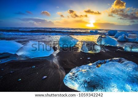 Ice rock with black sand beach at Jokulsarlon beach (Diamond beach) in southeast Iceland #1059342242