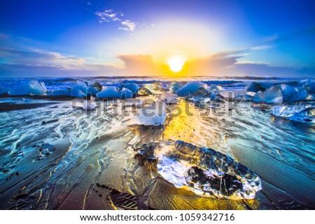 Ice rock with black sand beach at Jokulsarlon beach (Diamond beach) in southeast Iceland #1059342716