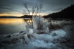 Ice sculptures on the shores of Jonsvatnet lake near Trondheim. Winter landscape from Norway. Sunset time.