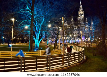 Ice Skaters Racing along an Ice Trail in Vienna's City Hall Park (Winter/ Christmas Time) - Vienna, Austria