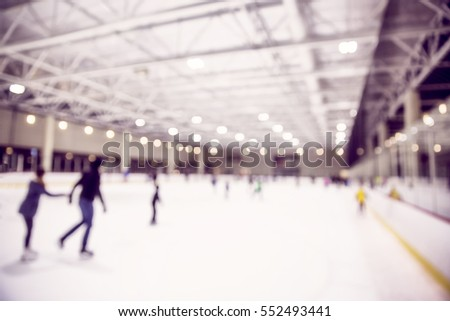 ice skating indoor rink with people. blurred background due to the concept. empty space for your text