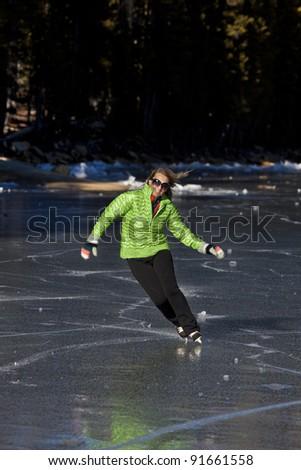 Ice skating on frozen Tenaya Lake in Yosemite National Park.