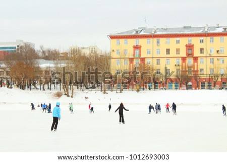 Ice skating rink. People skate on a skating rink in the city. Russia, January, 2018. #1012693003