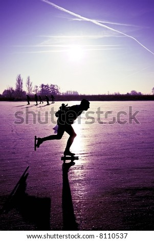 Ice skating with a beautiful purple sunset in the countryside of the Netherlands