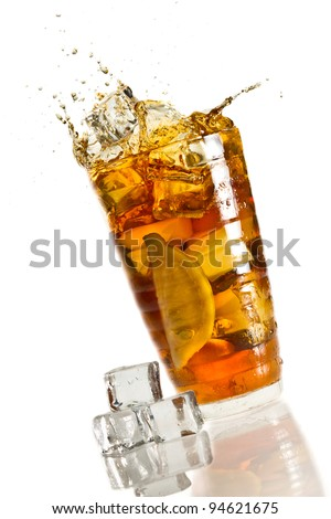 Ice splash in a glass with lemon tea