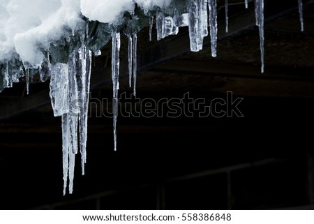 Shutterstock Ice stalactites on a black background.