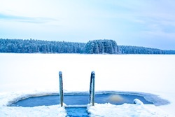 Ice swimming place from Kuhmo, Finland.	Cold snowy lake view.
