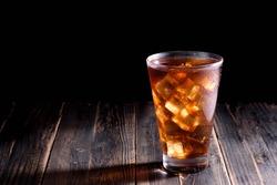 Ice tea  on wooden table / dark background