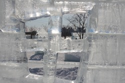 ice wall transparent sculpture in a park in Siberia in winter