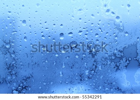 ice water drops on winter glass