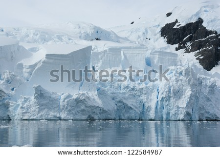 Iceberg breaks off from a glacier in the summer.