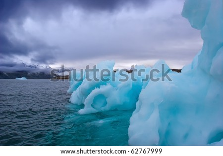 iceberg floating along greenland coasts