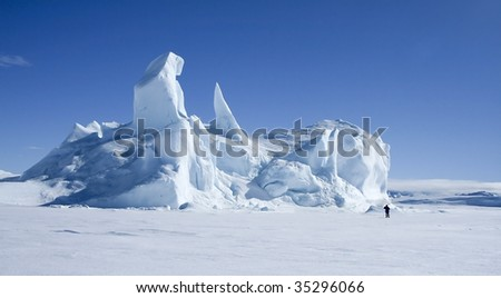 Iceberg frozen solid in the sea ice of Antarctica
