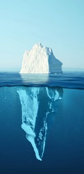 Iceberg - Hidden Danger And Global Warming Concept. Iceberg floating in the ocean with visible underwater part. Greenland Ice