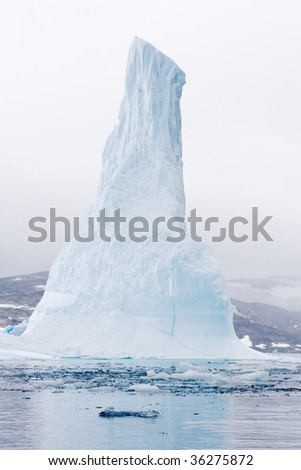Iceberg in the early morning mist in Nappasorsuaq Fjord, Greenland