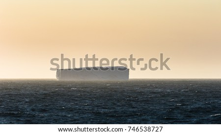 Iceberg Looming in the Distance off Coast of Greenland #746538727